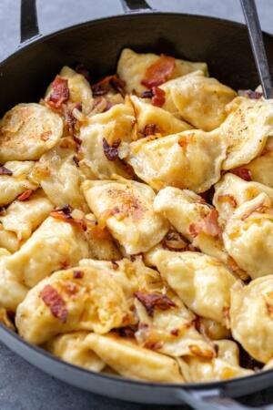 PIerogi with onion in a pan