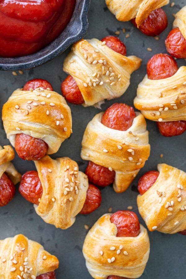 Baked pigs in a blanket on a serving tray