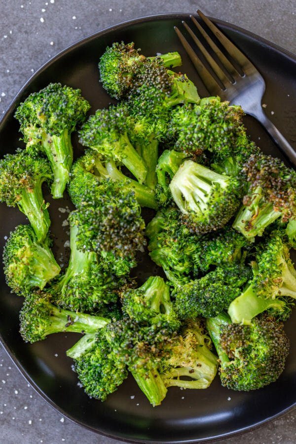 Broccoli on a plate with a fork