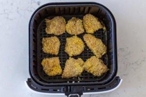 chicken nuggets in an air fryer basket