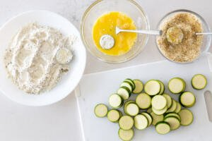 process of coating parmesan zucchini chips