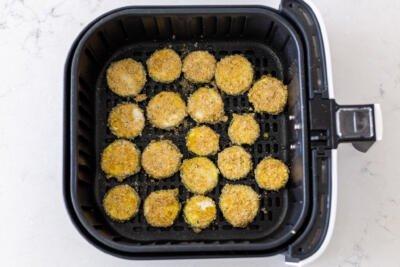 parmesan zucchini chips in air fryer basket