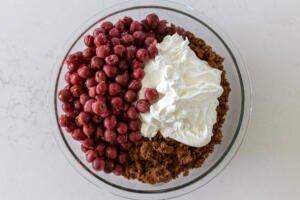 sponge cake, drunken cherries and cream in a bowl