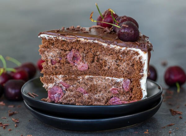 A slice of drunken cherry cake on a plate