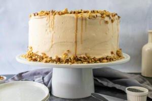 A honey walnut poppy seed cake on a stand