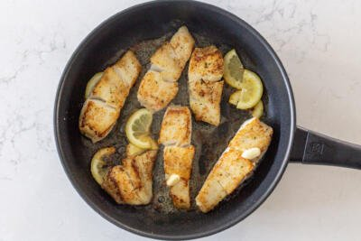 fried halibut in a pan