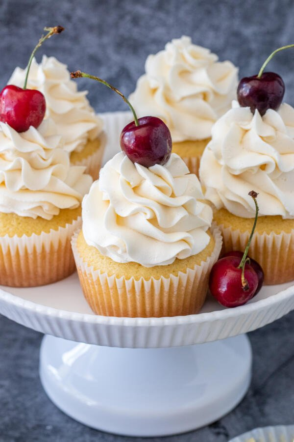 cupcakes on a cake stand with cherry