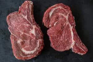 two rib eye steak on a plate