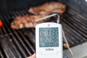 thermometer measuring temperature of the beef