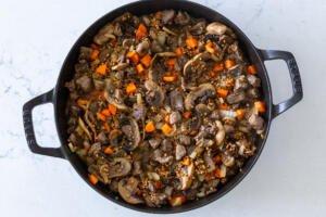 liquids added to buckwheat stew in a pan