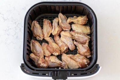 chicken wings in an air fryer basket