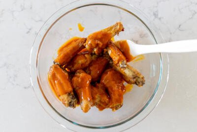 wings with buffalo sauce in a bowl