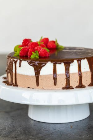 Birds milk cake on a cake stand