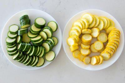 Sliced Zucchini and squash in bowls