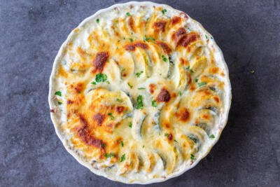 Cheesy Zucchini and Squash Casserole in a baking pan