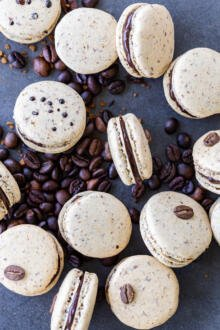 Coffee macarons on a pile of coffee beans