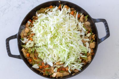 Cabbage added to the pan