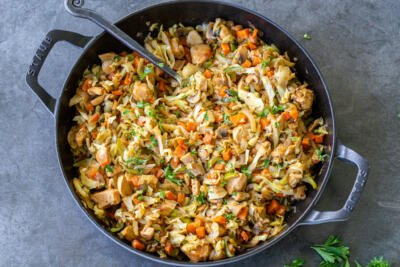 Braised cabbage with chicken in a pan
