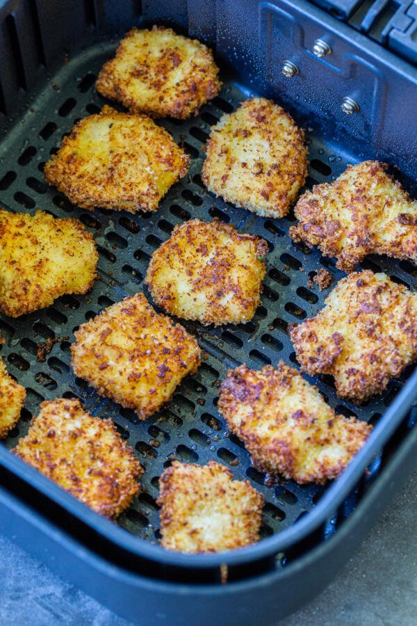 Cooked chicken nuggets in an air fryer