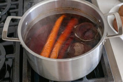 carrots and beets in a pot