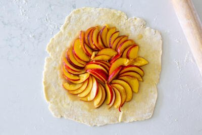 pie dough and peach filling in the center