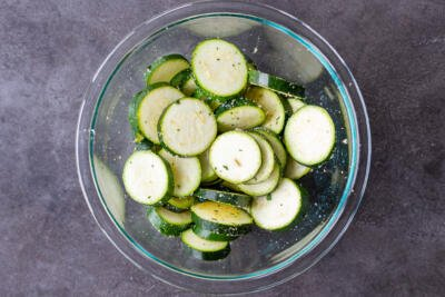 Bowl with zucchini slices and seasoning