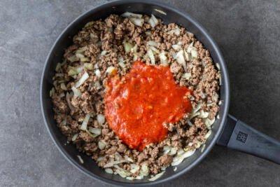 Marinara sauce added to the pan