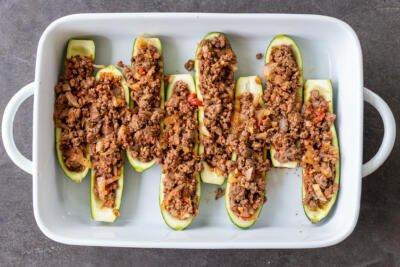 zucchini boats in a baking pan
