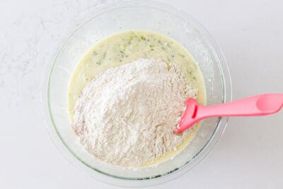 dry ingredients added to liquids in a bowl