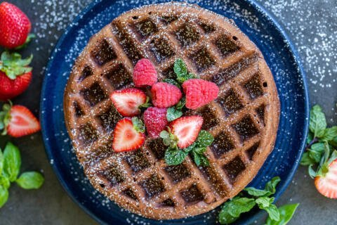 Chocolate waffles on a plate with berries