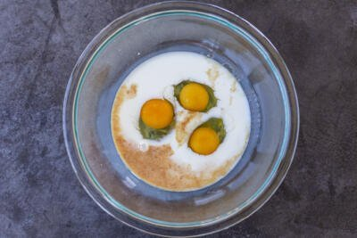 Eggs, milk and vanilla extract in a bowl