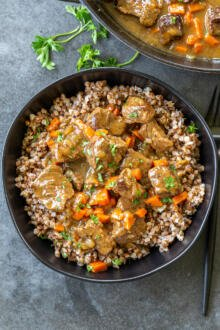 Beef stew gravy with buckwheat in a bowl