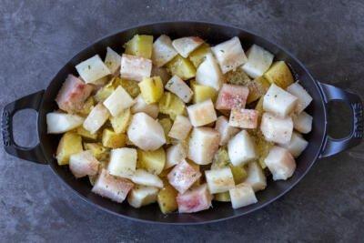 Season potatoes and cod